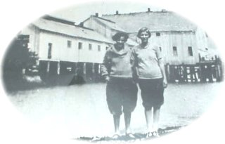 image of two ol gals in front of the Port Renfrew Cannery